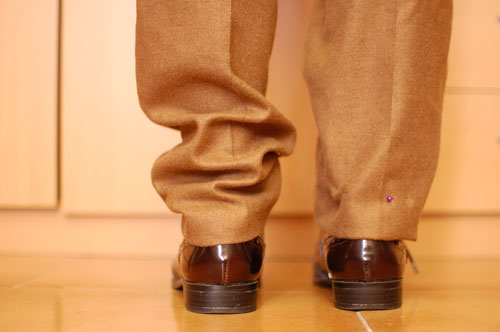 subir un bajo de pantalón