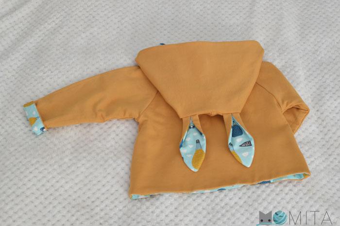 Coser ropa niño